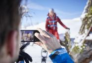 Austria, Tyrol, hiker taking a photo with smartphone - CVF00434