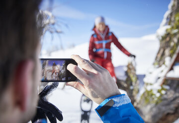 Austria, Tyrol, hiker taking a photo with smartphone - CVF00434