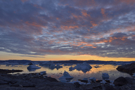 Greenland, East Greenland, view from Sarpaq over the icebergs of Sermilik fjord in the evening - ESF01651