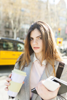 Spain, Barcelona, portrait of young businesswoman with coffee to go - VABF01561