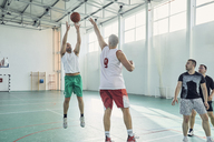 Men playing basketball, indoor - ZEDF01352