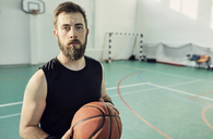 Portrait of bearded man with basketball, indoor - ZEDF01367