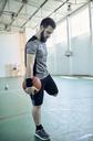 Man playing basketball, indoor - ZEDF01373