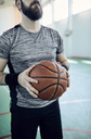 Man playing basketball, indoor - ZEDF01376