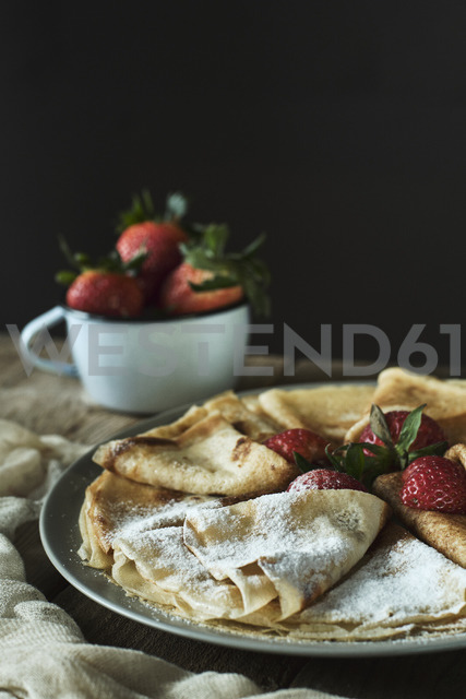 Homemade pancakes with  strawberries and icing sugar - BZF00390