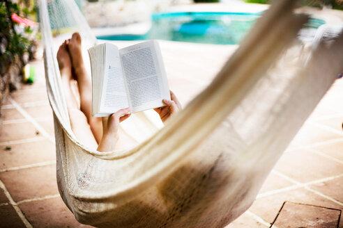 A woman asleep in a hammock - CUF01544