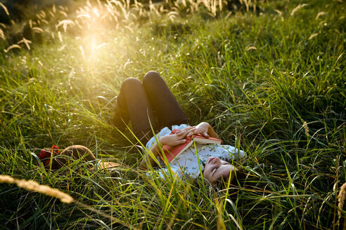 Woman sleeping in grass - CUF01695