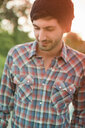 Portrait of young man in checked shirt - ISF00339