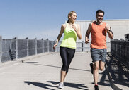 Fit couple jogging in the city - UUF13579