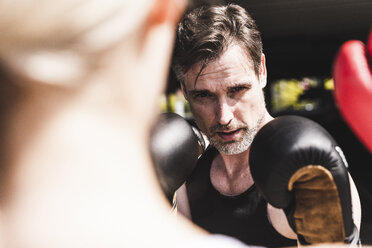 Man and woman in boxing training - UUF13630