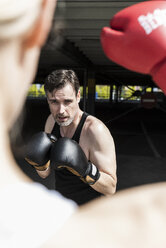 Man and woman in boxing training - UUF13633