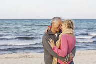Couple hugging on beach, Palma de Mallorca, Spain - CUF01907