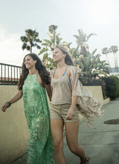 Two female friends, walking outdoors - CUF02089