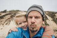 Portrait of father and son, outdoors, smiling, close-up - CUF02101