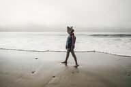 Young boy standing on beach, looking away - CUF02104