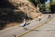 Three children, rolling downhill of toy cars - CUF02131