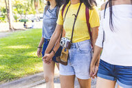 Friends walking and sightseeing in park, Bangkok, Thailand - CUF02209