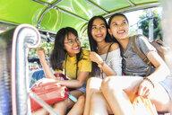 Friends sightseeing in tuk tuk car, Bangkok, Thailand - CUF02215