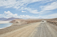 Recreational vehicle on empty road, Chiguana, Potosi, Bolivia, South America - CUF02295
