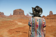 USA, Utah, Woman with cowboy hat enjoying the views in Monument Valley - GEMF01954