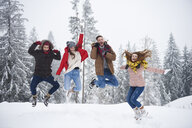 Friends jumping in snow - CUF02540