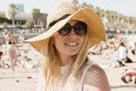 Portrait of woman on beach, Barcelona, Catalonia, Spain - CUF02543