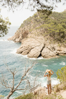 Woman along coastline, looking at view, elevated view, Tossa de mar, Catalonia, Spain - CUF02546