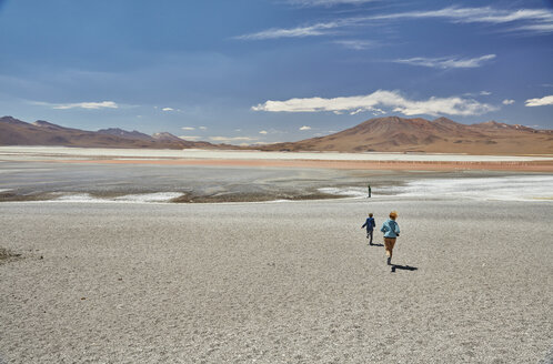 Mother and sons exploring landscape, Laguna Colorada, Colorada, Potosi, Bolivia, South America - CUF02630