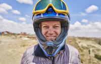 Portrait of woman wearing crash helmet, close-up, La Paz, Bolivia, South America - CUF02636