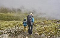 Mother and son, trekking through landscape, rear view, Ventilla, La Paz, Bolivia, South America - CUF02645