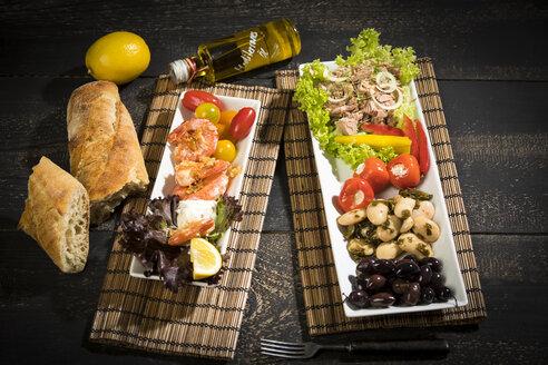 Antipasti, tuna, salad, filled paprika, white beans, black olive, shrimp, sour cream, tomato and white bread - MAEF12582