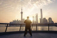 China, Shanghai, skyline with person doing morning sports - SPP00040