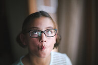 Girl puckering, making faces - CUF02832
