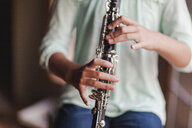 Young clarinettist playing her clarinet - CUF02838