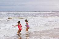 Two girls playing in ocean waves, Dauphin Island, Alabama, USA - CUF02964
