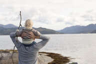 Man and son looking out at fjord, Aure, More og Romsdal, Norway - CUF03012
