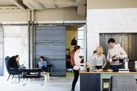 Architects taking break in coffee area - CUF03204