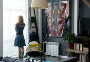 Woman looking out window at home - CUF03249