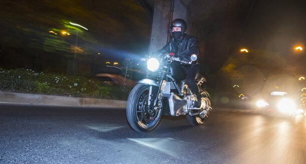Man riding electric motorbike, Bangkok, Thailand - CUF03318