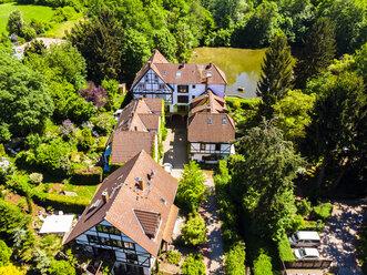 Germany, Hesse, Dreieich, Old mill with pond - AMF05720