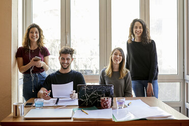 Portrait of four happy students at desk and at the window - JRFF01623