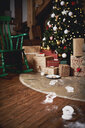 Christmas tree surrounded by presents, Santa's footprints leading towards tree - CUF03408