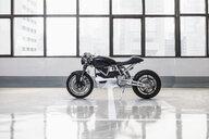 Electric cafe racer motorbike in garage - CUF03438