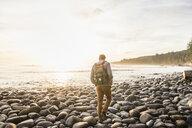 Rear view of man walking on beach in Juan de Fuca Provincial Park, Vancouver Island, British Columbia, Canada - CUF04078