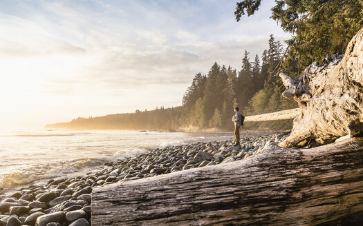 Man looking out from beach in Juan de Fuca Provincial Park, Vancouver Island, British Columbia, Canada - CUF04084
