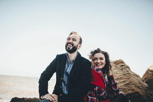 Mid adult couple laughing together on beach, Odessa Oblast, Ukraine - ISF00933