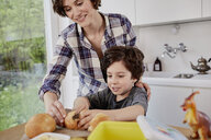 Mother and son preparing food in kitchen - ISF01043