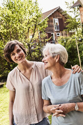 Portrait of senior woman with grown daughter, outdoors, smiling - ISF01112