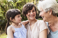 Portrait of senior woman with grown daughter and granddaughter, outdoors, smiling - ISF01118