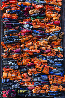 Colourful stacked migrant lifejackets exhibition - Soleil Levant by Chinese artist Ai Weiwei, Nyhavn, Copenhagen, Denmark - ISF01127